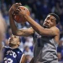 Kansas State guard Shane Southwell (1) rebounds against TCU forward Garlon Green (33) during the first half of an NCAA college basketball game in Manhattan, Kan., Tuesday, March 5, 2013. (AP Photo/Orlin Wagner)