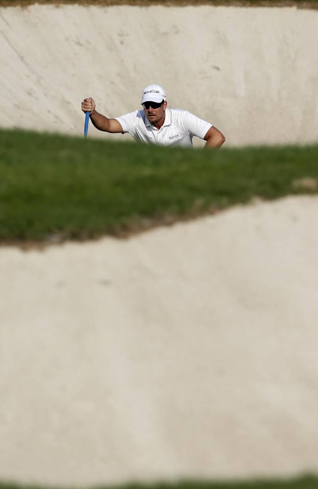 Stenson nears Euro money title, leads in Dubai