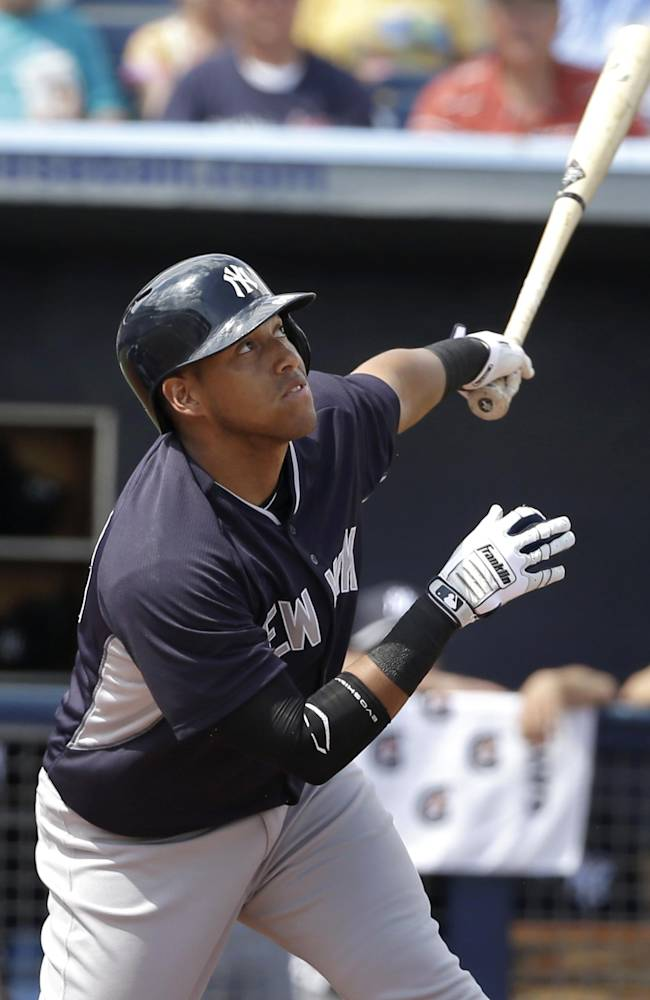 New York Yankees' Yangervis Solarte flies out off a pitch by Tampa Bay Rays' Cesar Ramos in the first inning of an exhibition baseball game, Wednesday, March 5, 2014, in Port Charlotte, Fla