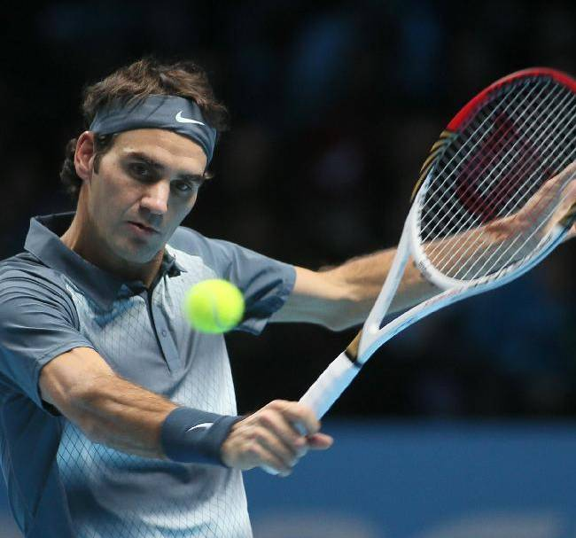 Roger Federer of Switzerland plays a return to Rafael Nadal of Spain during their ATP world Tour Finals tennis semifinal match at the O2 Arena on London, Sunday, Nov. 10, 2013