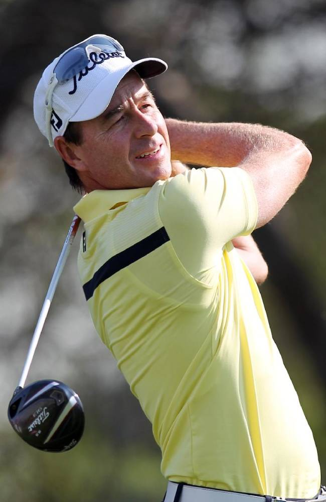 Brett Rumford of Australia hits his tee shot on the 16th hole during the second round of the Commercial Bank Qatar Masters at the Doha Golf Club in Doha, Qatar, Thursday, Jan. 23, 2014