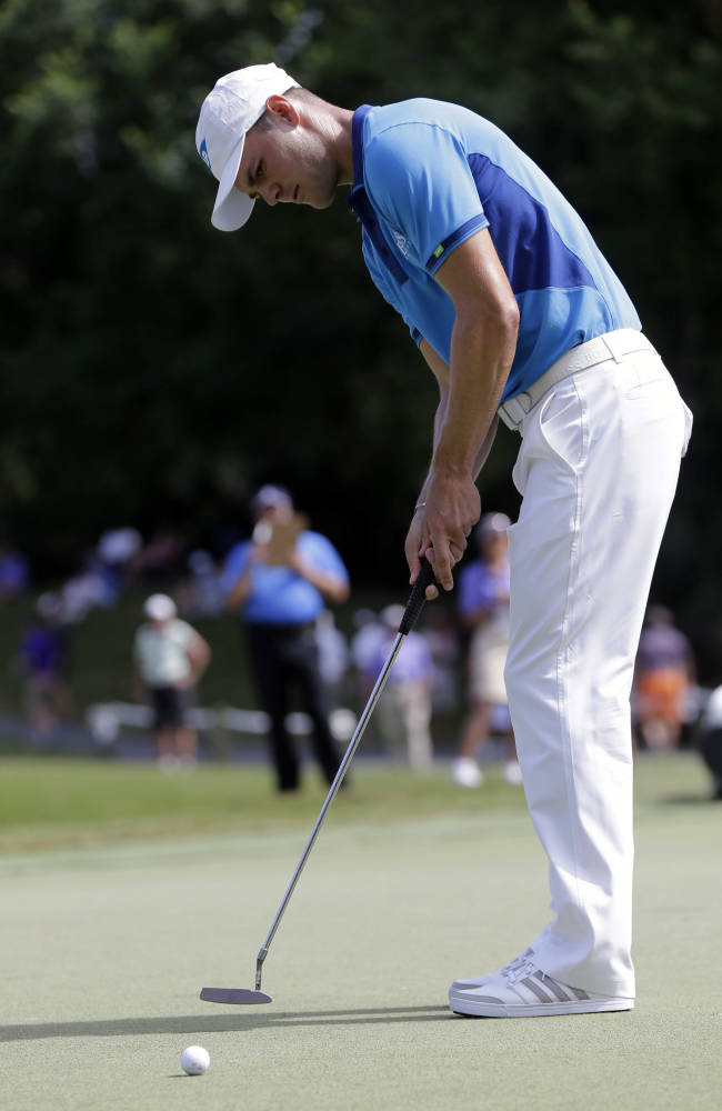 Martin Kaymer, of Germany, watches his putt on the sixth green during the third round of The Players championship golf tournament at TPC Sawgrass, Saturday, May 10, 2014, in Ponte Vedra Beach, Fla
