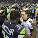 Seattle Seahawks' Kam Chancellor (31) talks with New Orleans Saints quarterback Drew Brees (9) after the Seahawks beat the Saints 34-7 in an NFL football game, Monday, Dec. 2, 2013, in Seattle The Associated Press