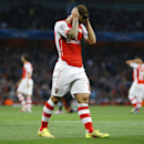 Arsenal's Jack Wilshere holds his head after a missed opportunity during a second leg Champions League qualifying soccer match between Arsenal and Besiktas at Emirates Stadium in London Wednesday, Aug. 27, 2014