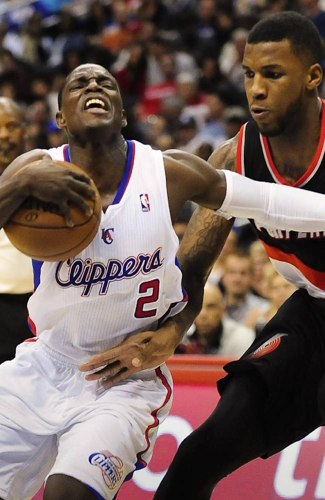 Los Angeles Clippers guard Darren Collison (2) gets by Portland Trail Blazers forward Thomas Robinson (41) in the second half of a pre-season NBA basketball game, Friday, Oct. 18, 2013, in Los Angeles. The Trail Blazers won 94-84
