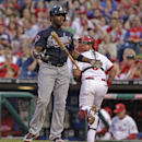Atlanta Braves' Justin Upton reacts after he struck out against the Philadelphia Phillies in the first inning of the MLB National League baseball game Monday, April 14, 2014, in Philadelphia The Associated Press
