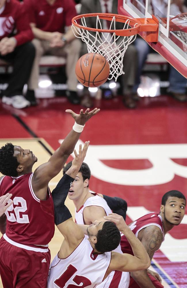 Indiana's Stanford Robinson (22) shoots against Wisconsin's Traevon Jackson (12) during the first half of an NCAA college basketball game, Tuesday, Feb. 25, 2014, in Madison, Wis