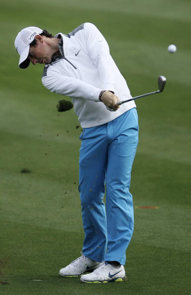 Rory McIlroy of Northern Ireland plays a ball on the 14t hole during the first round of the Dubai Desert Classic golf tournament in Dubai, United Arab Emirates, Thursday, Jan. 30, 2014