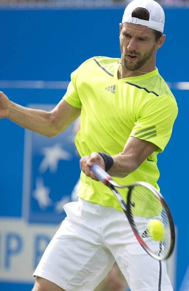 Austria's Jurgen Melzer plays a return to Britain's Daniel Evans during their first round Queen's Club grass court tennis tournament match in London, Monday June 9, 2014