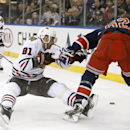 Chicago Blackhawks right wing Marian Hossa (81), of Slovakia, takes a ride on his stick as he falls while defending New York Rangers left wing Carl Hagelin (62) during the second period of an NHL hockey game at Madison Square Garden in New York, Thursday, Feb. 27, 2014. (AP Photo/Kathy Willens)