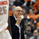 Syracuse head coach Jim Boeheim smiles late in the second half against Rutgers during an NCAA college basketball game in Syracuse, N.Y., Wednesday, Jan. 2, 2013. Syracuse won 78-53 for Boeheim's 903rd career victory passing Bobby Knight. (AP Photo/Kevin Rivoli)