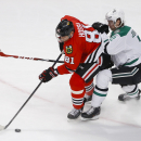 Chicago Blackhawks right wing Marian Hossa (81) tries to control the puck in front of Dallas Stars defenseman Jyrki Jokipakka (2) during the second period of an NHL hockey game, Sunday, Jan. 18, 2015, in Chicago The Associated Press