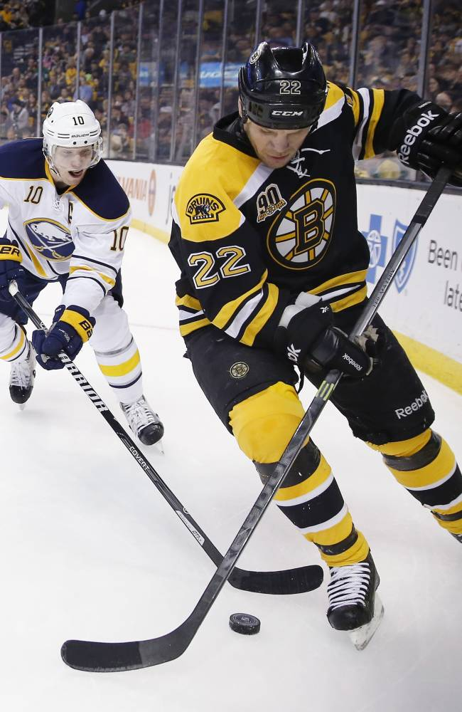 Bruins clinch NHL's top record, beat Sabres 4-1