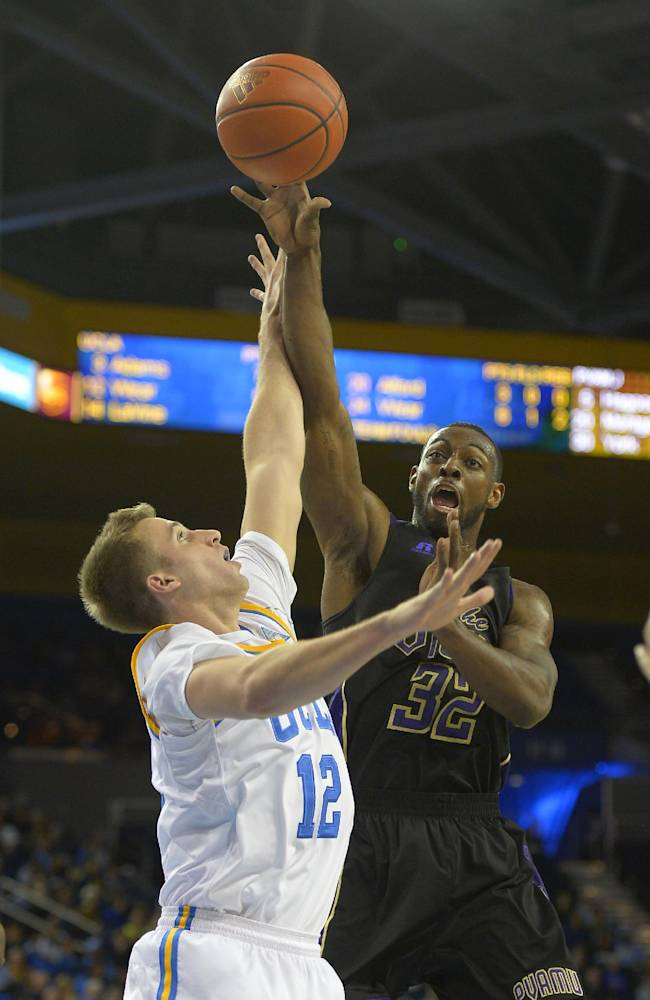 Prairie View forward Demondre Chapman (32) puts up a shot as UCLA forward David Wear (12) defends during an NCAA college basketball game, Saturday, Dec. 14, 2013, in Los Angeles