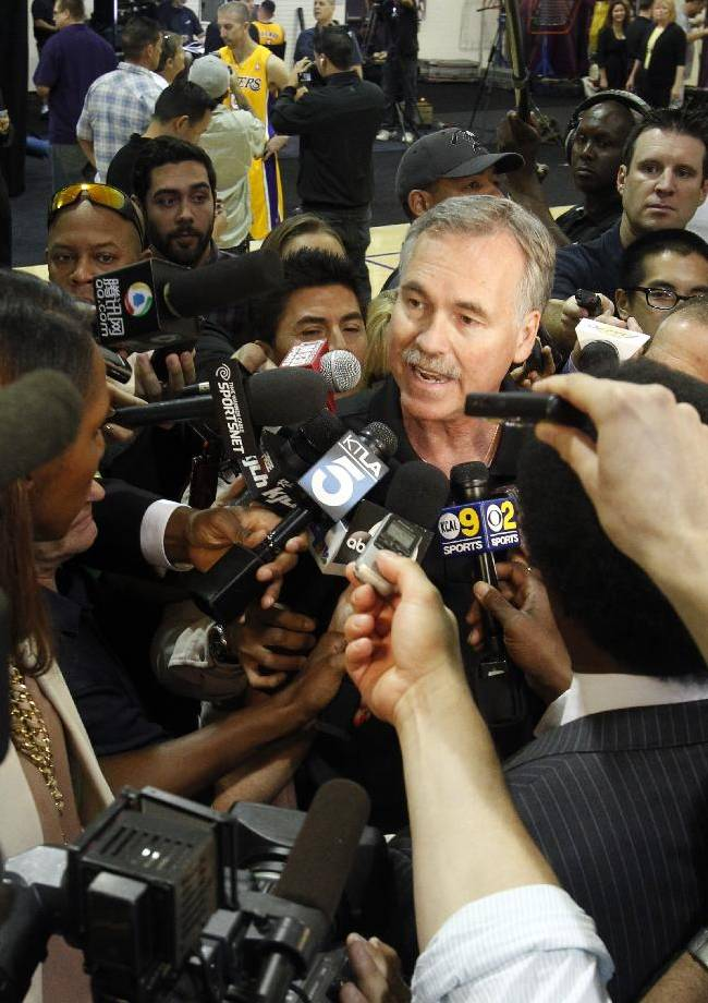 Los Angeles Lakers head coach Mike D'Antoni talks to reporters during their NBA basketball media day at the team's headquarters on Saturday, Sept. 28, 2013, in El Segundo, Calif