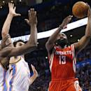 Houston Rockets guard James Harden (13) shoots in front of Oklahoma City Thunder forward Serge Ibaka (9) and center Steven Adams (12) during the second quarter of an NBA basketball game in Oklahoma City, Tuesday, March 11, 2014. Oklahoma City won 106-98. (AP Photo/Sue Ogrocki)