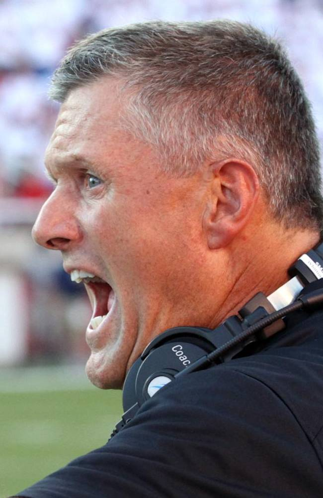 In this Aug. 29, 2013, file photo, Utah head coach Kyle Whittingham shouts to his player during the first quarter of an NCAA football game against Utah State in Salt Lake City. On Saturday, Utah hosts Oregon State, a team that has struggled to find its offense after the first two games of the season