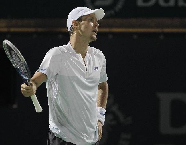 Tomas Berdych of Czech Republic reacts after losing a point against Roger Federer of Switzerland during the final match of the Dubai Duty Free Tennis Championships in Dubai, United Arab Emirates, Saturday, March 1, 2014
