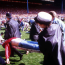 "FILE - In this April 15, 1989 file photo police, stewards and supporters tend and care for wounded supporters on the field at Hillsborough Stadium, in Sheffield, England. The 96 Liverpool soccer fans who died in the Hillsborough Stadium disaster were ""unl"
