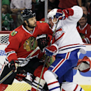Chicago Blackhawks defenseman Brent Seabrook (7), left, and Montreal Canadiens left wing Christian Thomas (60) battle for the puck during the first period of a preseason NHL hockey game in Chicago, Wednesday, Oct. 1, 2014 The Associated Press