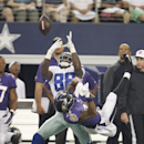 Dallas Cowboys wide receiver Dez Bryant (88) makes a catch against Baltimore Ravens cornerback Jimmy Smith (22) during the first half of an NFL preseason football game Saturday, Aug. 16, 2014, in Arlington, Texas The Associated Press