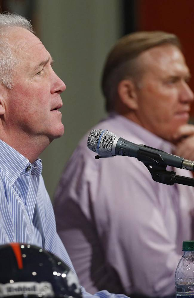 Denver Broncos head coach John Fox, left, speaks as Vice President John Elway, right, listens during an end of the season news conference at the NFL football team's headquarters in Englewood, Colo., on Tuesday, Feb. 4, 2014