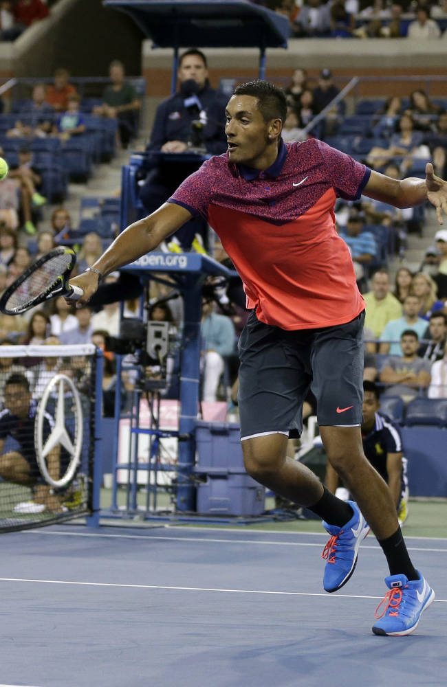 Nick Kyrgios, of Australia, returns a shot to Tommy Robredo, of Spain, during the third round of the 2014 U.S. Open tennis tournament Saturday, Aug. 30, 2014, in New York