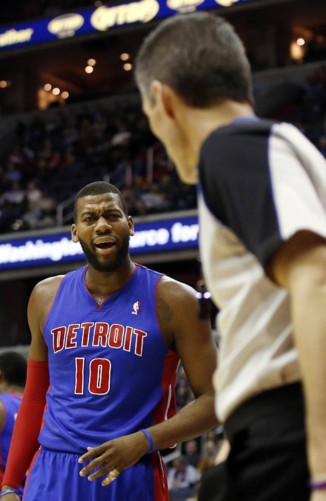 Detroit Pistons forward Greg Monroe (10) questions a call by referee Scott Foster in the first half of an NBA basketball game against the Washington Wizards, Saturday, Jan. 18, 2014, in Washington