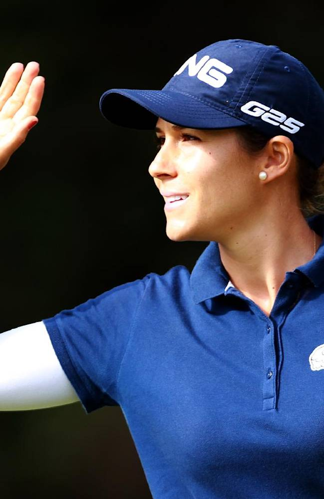Azahara Munoz of Spain reacts at the 18th hole at the women's Open in Saint Jean de Luz, southwestern France, Sunday, Sept.29, 2013. She wins the Golf Open