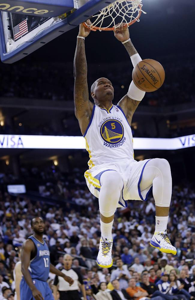 Golden State Warriors' Marreese Speights (5) dunks during the second half of an NBA basketball game against the Minnesota Timberwolves on Monday, April 14, 2014, in Oakland, Calif. Golden State won 130-120