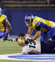 San Jose State's Thomas Tucker, left, runs past Navy linebacker Jordan Drake (13) as guard Nicholas Kaspar (75) blocks during the first half of an NCAA college football game on Friday, Nov. 22, 2013, in San Jose, Calif. (AP Photo/Marcio Jose Sanchez)