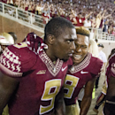Florida State's Jalen Ramsey, right, celebrates with Karlos Williams in the end zone after Williams' game-winning touchdown in overtime of an NCAA college football game against Clemson in Tallahassee, Fla., Saturday, Sept. 20, 2014. Florida State won 23-17 in overtime. (AP Photo/Mark Wallheiser)
