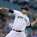Seattle Mariners starting pitcher James Paxton makes his major-league debut as he pitches against the Tampa Bay Rays in the first inning of a baseball game, Saturday, Sept. 7, 2013, in Seattle. (AP Photo/Ted S. Warren)