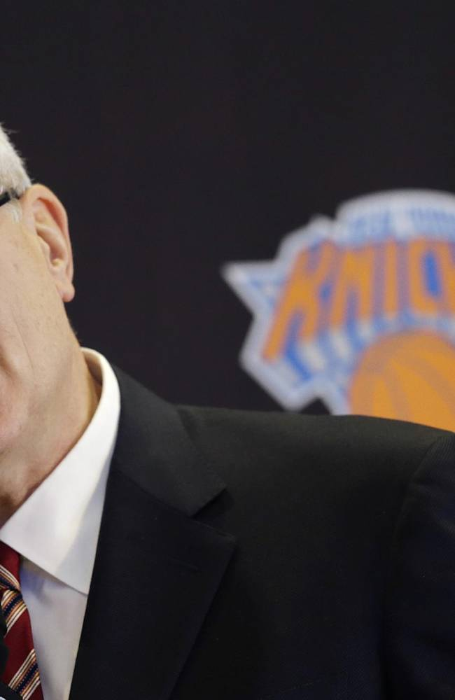 Phil Jackson, the new president of the New York Knicks, answers questions during a news conference, Tuesday, March 18, 2014 in New York. Jackson, who won two NBA titles as a player with the Knicks, also won 11 championships while coaching the Chicago Bulls and the Los Angeles Lakers