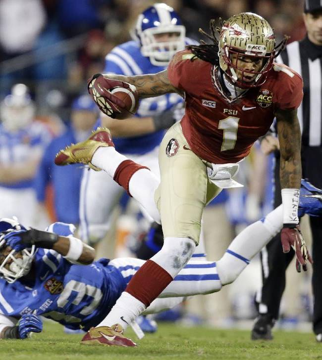 Florida State's Kelvin Benjamin (1) runs past Duke's Michael Westray (13) in the first half of the Atlantic Coast Conference Championship NCAA football game in Charlotte, N.C., Saturday, Dec. 7, 2013. Florida State won 45-7