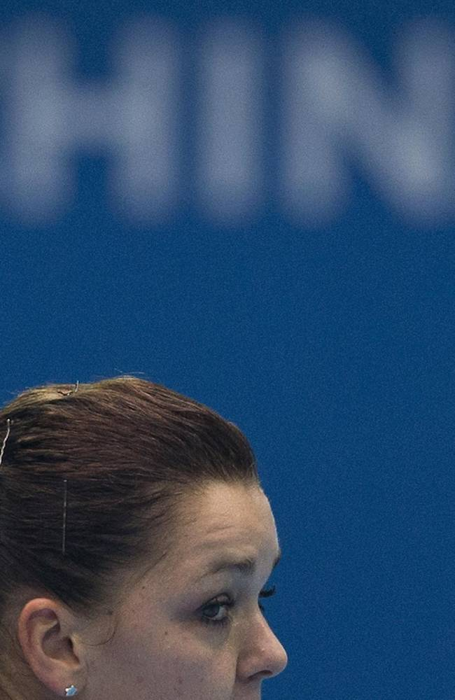 Agnieszka Radwanska of Poland returns a ball to Stefanie Voegele of Switzerland during their first round of the China Open tennis tournament at the National Tennis Stadium in Beijing, China Sunday, Sept. 29, 2013