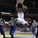 Charlotte Bobcats' Bismack Biyombo (0) dunks against the Dallas Mavericks during the second half of an NBA basketball game in Charlotte, N.C., Tuesday, Feb. 11, 2014. The Bobcats won 114-89 The Associated Press