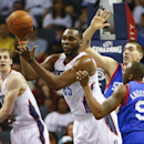 Charlotte Bobcats center Al Jefferson, center, looks to pas the ball against the Philadelphia 76ers during the second half of an NBA basketball game in Charlotte, N.C., Saturday, April 12, 2014 The Associated Press