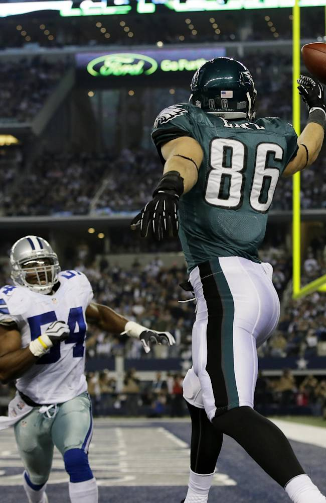 Philadelphia Eagles tight end Zach Ertz (86) misses a pass to the end zone as Dallas Cowboys outside linebacker Bruce Carter (54) defends during the second half of an NFL football game, Sunday, Dec. 29, 2013, in Arlington, Texas