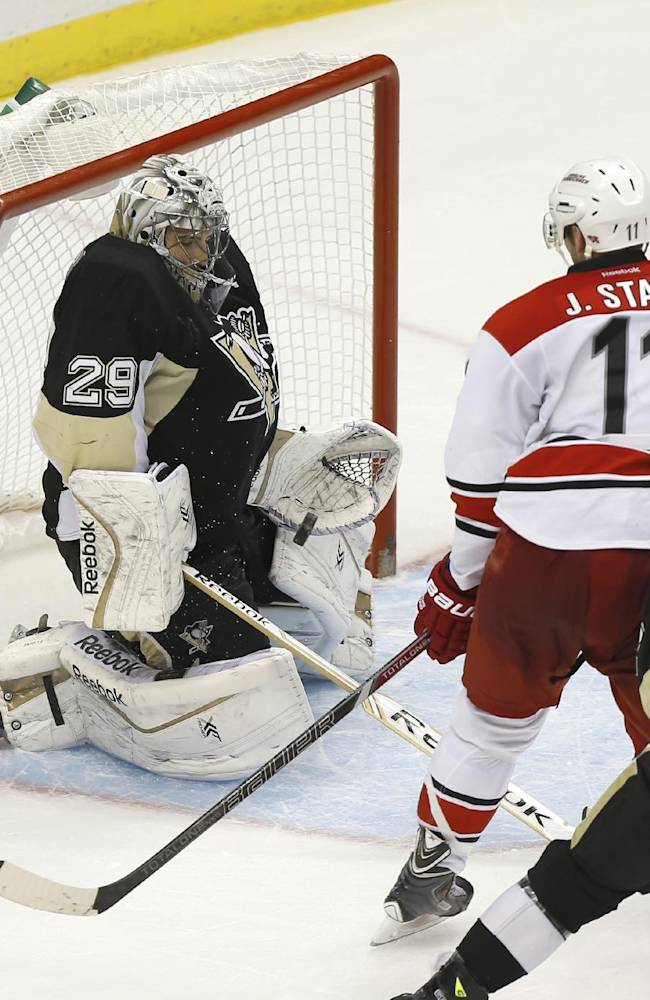 Pittsburgh Penguins goalie Marc-Andre Fleury (29) stops a shot by Carolina Hurricanes' Jordan Staal (11) during the third period of an NHL hockey game on Tuesday, April 1, 2014, in Pittsburgh. The Hurricanes won 4-1