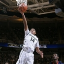 Michigan State's Gary Harris (14) puts up a layup in front of Illinois' D.J. Richardson (1) during the second half of an NCAA college basketball game, Thursday, Jan. 31, 2013, in East Lansing, Mich. Michigan State won 80-75. (AP Photo/Al Goldis)