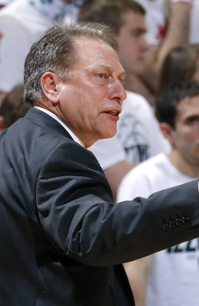 Michigan State coach Tom Izzo yells instructions during the second half of an NCAA college basketball game against Indiana, Tuesday, Jan. 21, 2014, in East Lansing, Mich. Michigan State won 71-66
