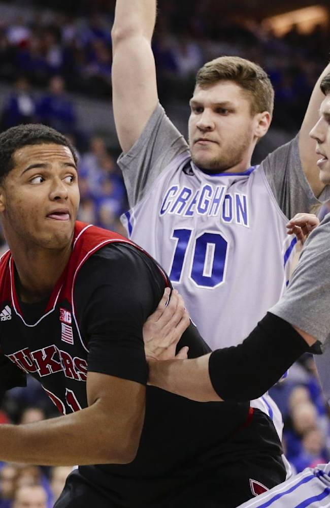 In this file photo from Dec. 8, 2013, Nebraska's Shavon Shields, left, is defended by Creighton's Grant Gibbs (10) and Doug McDermott (3) during an NCAA college basketball game in Omaha, Neb. With Gibbs as his wingman for three years, McDermott has ascended to near the top of the NCAA's all-time scoring chart. The two share an uncommon connection on the court, and off the court, they're best buddies