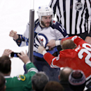 Winnipeg Jets right wing Anthony Peluso (14) and Chicago Blackhawks left wing Bryan Bickell fight during the first period of an NHL hockey game Friday, Jan. 16, 2015, in Chicago The Associated Press