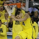 Michigan's Mitch McGary (4) heads to the court after a shot against Syracuse during the second half of the NCAA Final Four tournament college basketball semifinal game Saturday, April 6, 2013, in Atlanta. (AP Photo/Chris O'Meara)