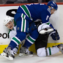 Dallas Stars' Antoine Roussel, left, and Vancouver Canucks' Yannick Weber, of Switzerland, collide during the second period of an NHL hockey game Wednesday, Dec. 17, 2014, in Vancouver, British Columbia The Associated Press