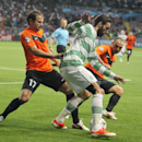 Shakhter's Andrei Poryvaev, left, and Andrei Finonchenko, right, fight for the ball with Celtic's Giorgos Samaras, center, during their Champions League playoff first leg soccer match in Astana, Kazakhstan, Tuesday, Aug. 20, 2013. (AP Photo/Alexei Filippov)