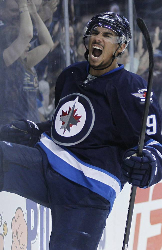 Winnipeg Jets' Evander Kane (9) celebrates his goal against the Colorado Avalanche during second period NHL action in Winnipeg on Wednesday, March 19, 2014. THE CANADIAN PRESS/John Woodsduring the second period of an NHL hockey game Wednesday, March 19, 2014, in Winnipeg, Manitoba