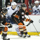 The Ducks' Rickard Rakell(67) controls the puck past the Maple Leafs' David Clarkson during a game at Honda Center on Wednesday Jan. 14, 2015 The Associated Press