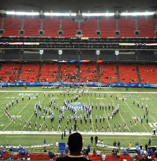 The Georgia Dome is nearly empty as the marching band takes the field for pre-game activities before Georgia State faces Louisiana-Lafayette in an NCAA football game on Saturday, Nov. 16, 2013, in Atlanta